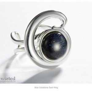 Twisted design blue stone ring